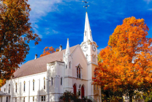 exterior photo of First Church in autumn